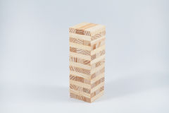 Wood block tower. Wooden jenga on the white background Stock Photography