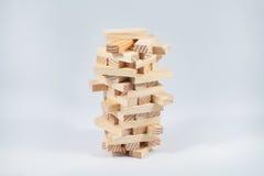 Wood block tower. Wooden jenga on the white background Stock Image