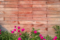Wood Block Wall With Flowers. A wood block wall is a kind of construction Royalty Free Stock Images
