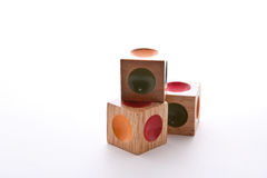 Wood Blocks. Wooden blocks puzzle with indents of different colors Royalty Free Stock Photo
