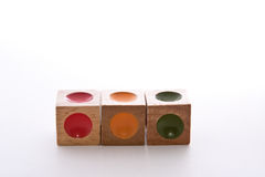 Wood Blocks. Wooden blocks puzzle with indents of different colors Stock Image