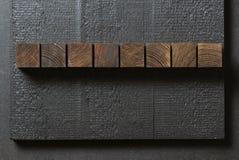 Wood blocks on black background Stock Image