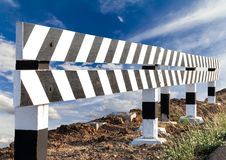 Wood blocks, black and white with sky clouds stock image