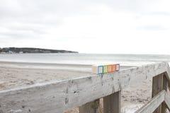 Wood blocks by boardwalk on beach Stock Images