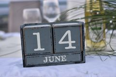 Wood blocks in box with date, day and month 14 June. Wooden blocks calendar royalty free stock photography