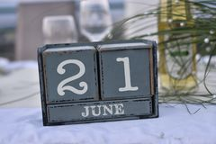 Wood blocks in box with date, day and month 21 June. Wooden blocks calendar royalty free stock photos