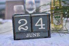 Wood blocks in box with date, day and month 24 June. Wooden blocks calendar stock photo