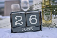 Wood blocks in box with date, day and month 26 June. Wooden blocks calendar royalty free stock images