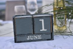 Wood blocks in box with date, day and month 1 June. Wooden blocks calendar stock image