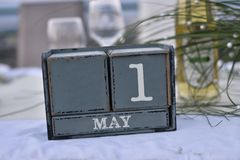 Wood blocks in box with date, day and month 1 May. Wooden blocks. Wood blocks in box with date, day and month 1 April. Wooden blocks calendar stock images