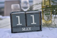 Wood blocks in box with date, day and month 11 May. Wooden block. S calendar royalty free stock images