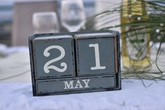 Wood blocks in box with date, day and month 21 May. Wooden block. S calendar royalty free stock image