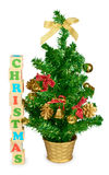 Wood blocks forming the word christmas and tree Stock Images