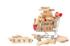 Wood blocks in shopping cart. Selective focus Stock Image