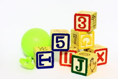 Wood blocks and a small ball Royalty Free Stock Photos