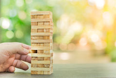 Wood blocks stack game ,Planning, risk and strategy, business background concept.  Stock Photo