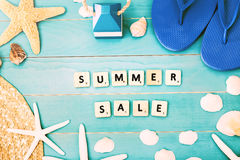 Wood Blocks on a Table for Summer Sale Concept Stock Image