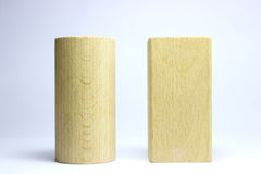 Wood Blocks. Two Woodblocks. A round woodblock and a square woodblock. Toys royalty free stock photo