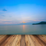 Wood and blur sea and sunset Stock Photos