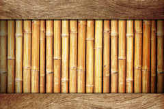 Wood board on bamboo Royalty Free Stock Photography