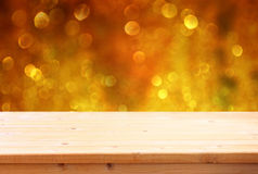 Wood board and blurred bokeh lights Royalty Free Stock Image