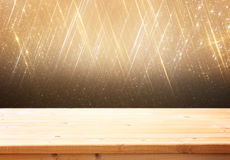 Wood board and blurred bokeh lights. room for product display. Stock Photos