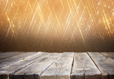 Wood board and blurred bokeh lights. room for product display Royalty Free Stock Photo