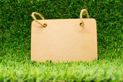 Wood board on the grass royalty free stock photos