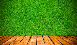 Wood board and grass background Royalty Free Stock Photos