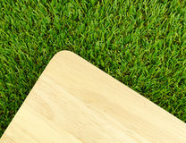 Wood board on green grass Stock Photography