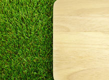 Wood board on green grass Royalty Free Stock Photography