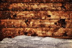 Wood board and mound of snow. Snowing blizzard. Stock Images