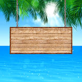 Wood Board Notice on Tropical Background Royalty Free Stock Image