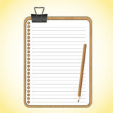 Wood board and paper sheet. With black paper clip Royalty Free Stock Photo
