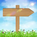 Wood board sign with grass and sky background. A wood board sign with grass and sky background Royalty Free Stock Images