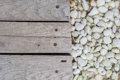 Wood board on stone Royalty Free Stock Photography