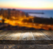 Wood board table in front of night sea landscape. Ready for product display montages Royalty Free Stock Image