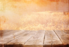 Wood board table in front of summer landscape with lens flare. Stock Photography