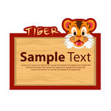 Wood board with tiger for your design Stock Images
