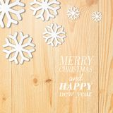 Wood board with white snow and stars. Stock Photos