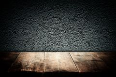 Wood boards and dark wall background. For product presentation stock image
