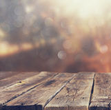 Wood boards and nature backgrounds of summer light among trees Stock Photos