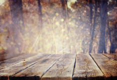 Wood boards and nature backgrounds of summer light among trees stock images