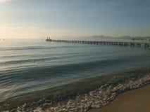 Wood boards old pier, Beautiful Mallorca landmark, Playa de Muro sunrise Royalty Free Stock Images