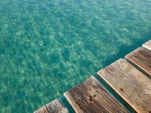 Wood boards old pier, Muro beach Majorca island, Spain Royalty Free Stock Image