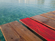 Wood boards old pier, Muro beach Majorca island, Spain Royalty Free Stock Photos