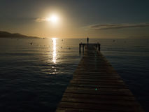 Wood boards old pier, Playa de Muro beach sunrise, Mallorca, Spain Stock Images