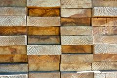 Wood boards stacked highly tightly. Stacked wooden board pattern with irregularities Royalty Free Stock Photography