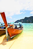 Wood boat on beach with blue sky Stock Photography