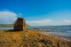 Wood boat on the coast Royalty Free Stock Photo